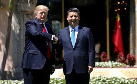 U.S. President Trump and China's President Xi  shake hands during walk at the Mar-a-Lago estate after a bilateral meeting in Palm Beach