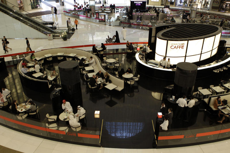 People enjoy their free time at Armani Cafe in Dubai Mall in Dubai, United Arab Emirates, Tuesday, Sept. 25, 2012. Vogue's fashion-loving fans will soon have a chance to drink in the magazine's aura at a new Cafe in Dubai. (AP Photo/Kamran Jebreili)