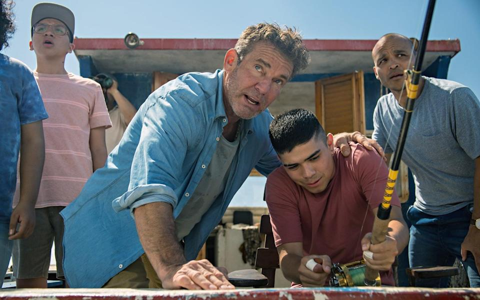 BLUE MIRACLE, center: Dennis Quaid, right: Jimmy Gonzales, 2021. ph: Carlos Rodriguez /  Netflix /Courtesy Everett Collection