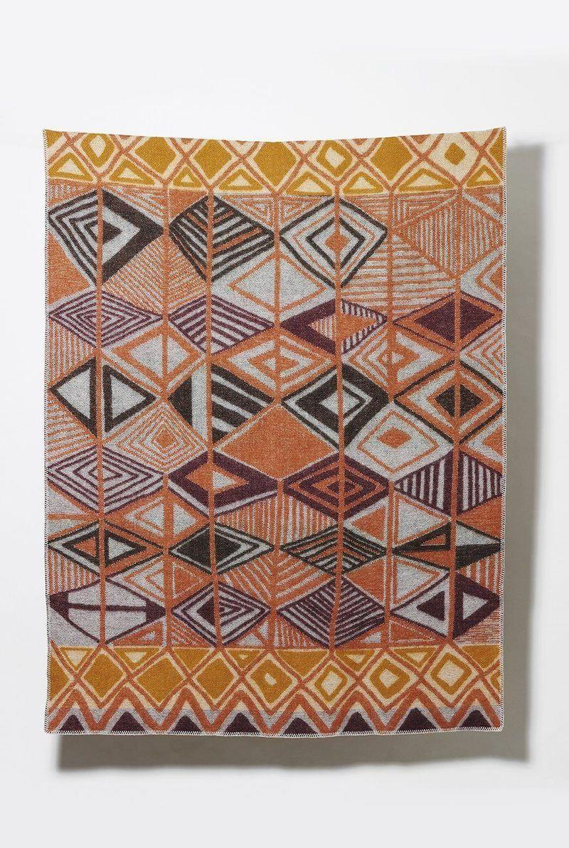 """<p><strong>Zig Zag Zurich</strong></p><p>zigzagzurich.com</p><p><strong>$221.42</strong></p><p><a href=""""https://zigzagzurich.com/collections/artist-wool-blankets-1/products/dakar-wool-blanket-by-sophie-probst"""" rel=""""nofollow noopener"""" target=""""_blank"""" data-ylk=""""slk:Shop Now"""" class=""""link rapid-noclick-resp"""">Shop Now</a></p><p>Known for their high quality, Zig Zag Zurich's New Zealand wool blankets will keep you warm and comfortable all season long. </p>"""
