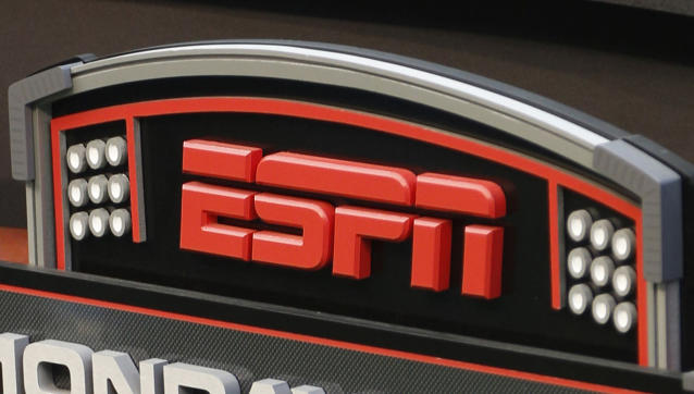 FILE - In this Sept. 16, 2013, file photo, an ESPN logo is seen prior to an NFL football game between the Cincinnati Bengals and the Pittsburgh Steelers in Cincinnati. The network will air the inaugural Overwatch League Grand Finals in prime time this month as part of a multiyear agreement to bring esports to the biggest sports platform on American television. Disney and Blizzard Entertainment announced plans Wednesday, July 11, 2018, to broadcast the OWLs playoffs and championship on ESPN, ABC and Disney XD. The Grand Finals on July 27 and 28 will be shown live on ESPN, marking the first time the network will carry esports in prime time. (AP Photo/David Kohl, File)