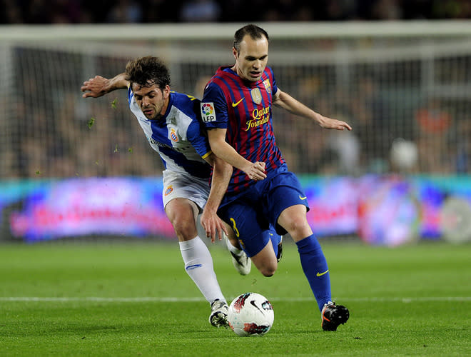 Espanyol's midfielder Victor Sanchez Mata (L) vies with Barcelona's midfielder Andres Iniesta (R) during the Spanish League football match FC Barcelona vs RCD Espanyol at the Camp Nou stadium in Barcelona on May 5, 2012. AFP PHOTO/ JOSEP LAGOJOSEP LAGO/AFP/GettyImages