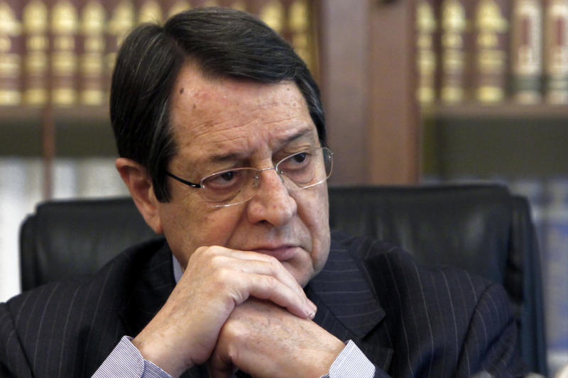 Cyprus' President Nicos Anastasiades listens during an interview with Associated Press at his office in the presidential palace in capital Nicosia, Cyprus, on Monday, Feb. 17, 2014. Cyprus' president says an agreement reunifying the ethnically-divided island nation would allow energy hungry Turkey to be supplied with newly found Cypriot and Israeli natural gas and would contribute to mending broken-down relations between Ankara and Tel Aviv. (AP Photo/Petros Karadjias)