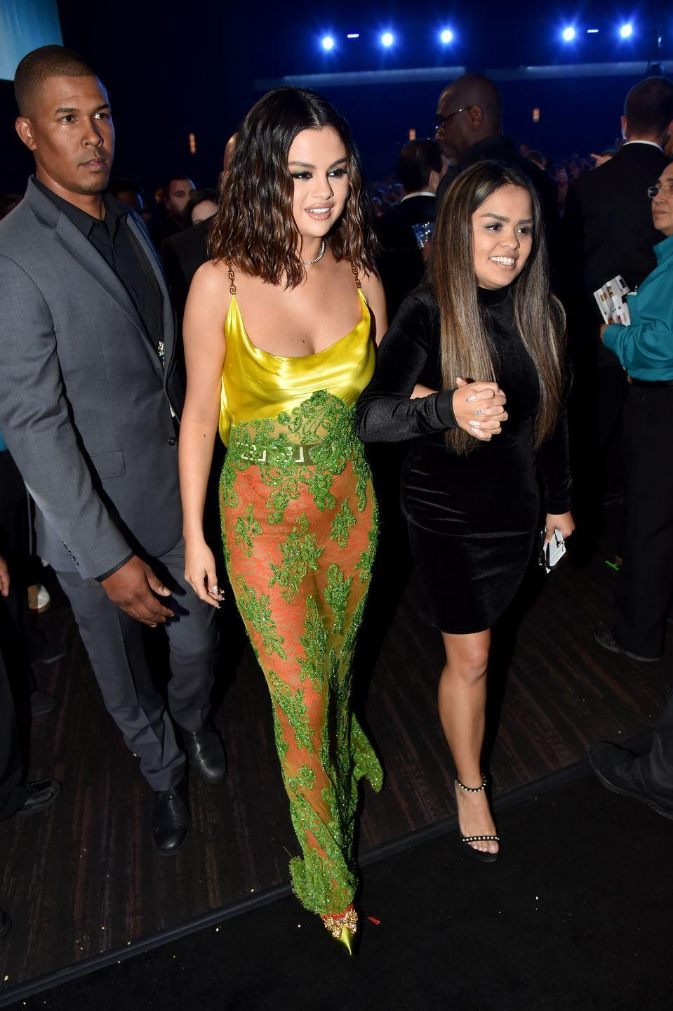 "<p>Heading back to her seat after opening the 2019 American Music Awards in a <a href=""https://www.elle.com/culture/celebrities/a29936299/selena-gomez-fourth-amas-outfit-2019/"" rel=""nofollow noopener"" target=""_blank"" data-ylk=""slk:sneaky outfit change"" class=""link rapid-noclick-resp"">sneaky outfit change</a>.</p>"