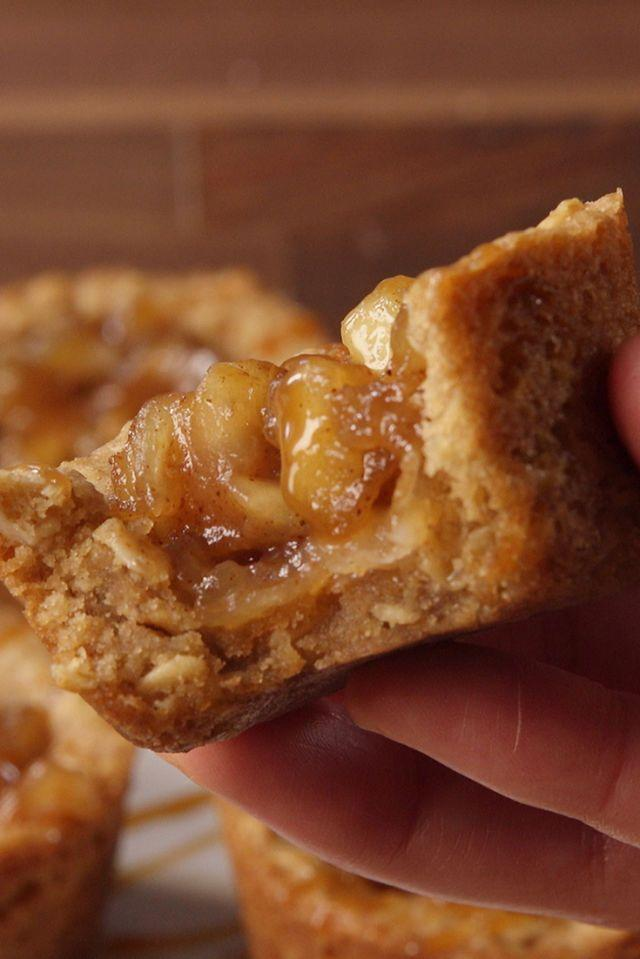 """<p>This bite-sized version of a classic apple crisp the perfect snack to warm you up on Halloween night.</p><p><em><a href=""""https://www.goodhousekeeping.com/food-recipes/dessert/a40715/apple-crisp-cookie-cups-video/"""" rel=""""nofollow noopener"""" target=""""_blank"""" data-ylk=""""slk:Get the recipe for Oatmeal Cookie Cups »"""" class=""""link rapid-noclick-resp"""">Get the recipe for Oatmeal Cookie Cups »</a></em></p><p><strong>RELATED: </strong><a href=""""https://www.goodhousekeeping.com/food-recipes/dessert/g768/apple-dessert-recipes/"""" rel=""""nofollow noopener"""" target=""""_blank"""" data-ylk=""""slk:40 Apple Desserts That Are Delicious to the Core"""" class=""""link rapid-noclick-resp"""">40 Apple Desserts That Are Delicious to the Core</a><br></p>"""