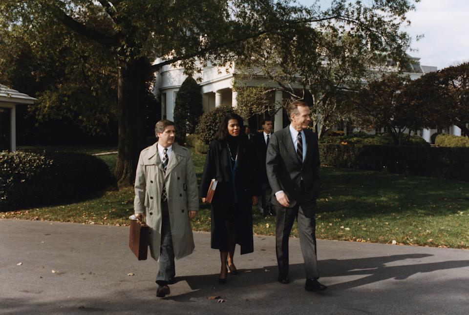 From left, Andy Card, Judy Smith and George H.W. Bush