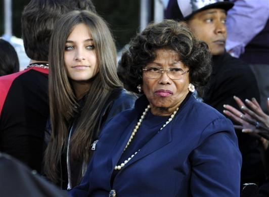 Michael Jackson's daughter Paris and mother Kathleen attend a ceremony where the singer is immortalized by placing hand and foot imprints in cement in the courtyard of Hollywood's Grauman's Chinese Theatre in Los Angeles, January 26, 2012.