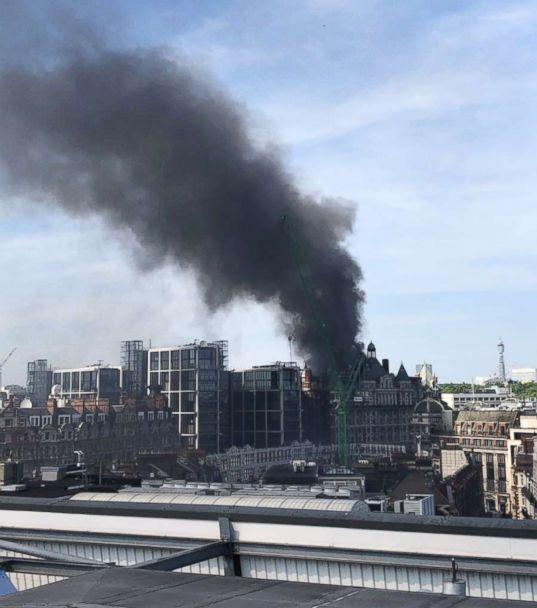 PHOTO: Clouds of smoke from the Mandarin Hotel at Knightsbridge, London, June 6, 2018, in a photo posted on the Twitter account of the London Fire Department. (London Fire Brigade / Twitter)