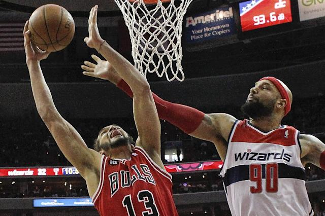 Chicago Bulls center Joakim Noah (13) shoots under pressure from Washington Wizards forward Drew Gooden (90) during the first half of Game 4 of an opening-round NBA basketball playoff series in Washington, Sunday, April 27, 2014. (AP Photo/Alex Brandon)