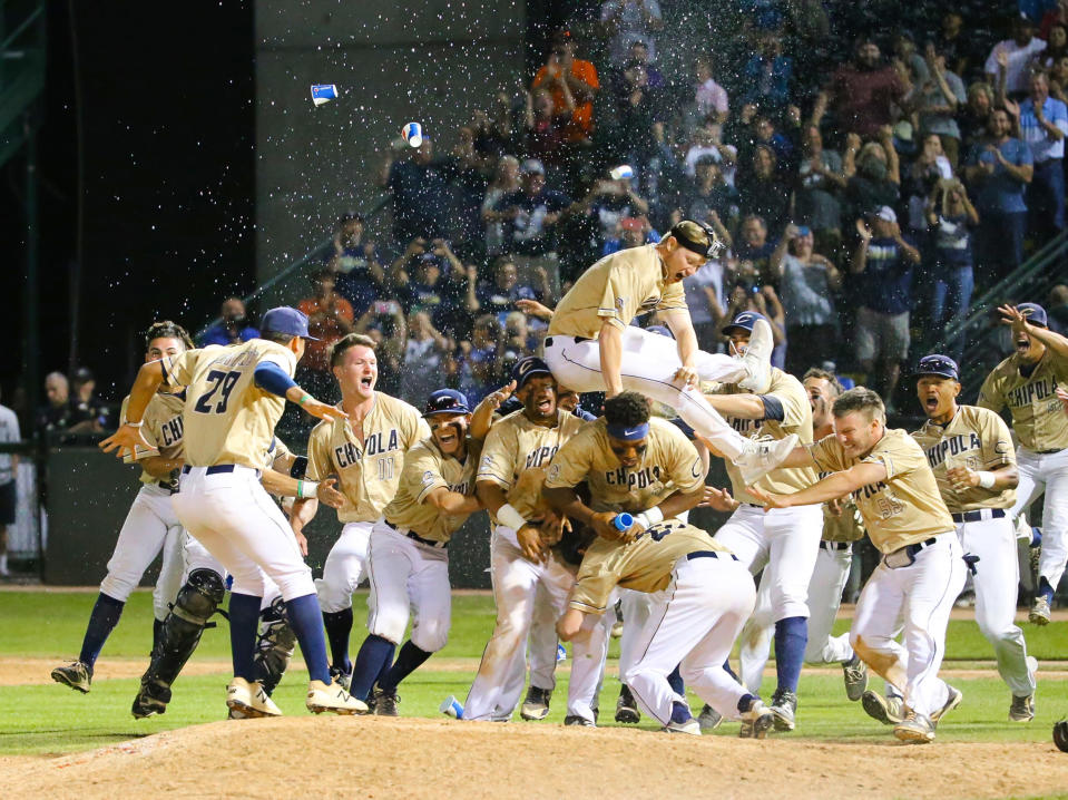 The Chipola College team celebrates after winning the JUCO college baseball World Series, on June 2, 2018, in Grand Junction, Colo. The Junior College World Series is on again after being canceled in 2020 because of the pandemic. The double-elimination tournament, also known as the JUCO World Series, has been held in Grand Junction since 1959. (Courtesy of Todd Bennett via AP)