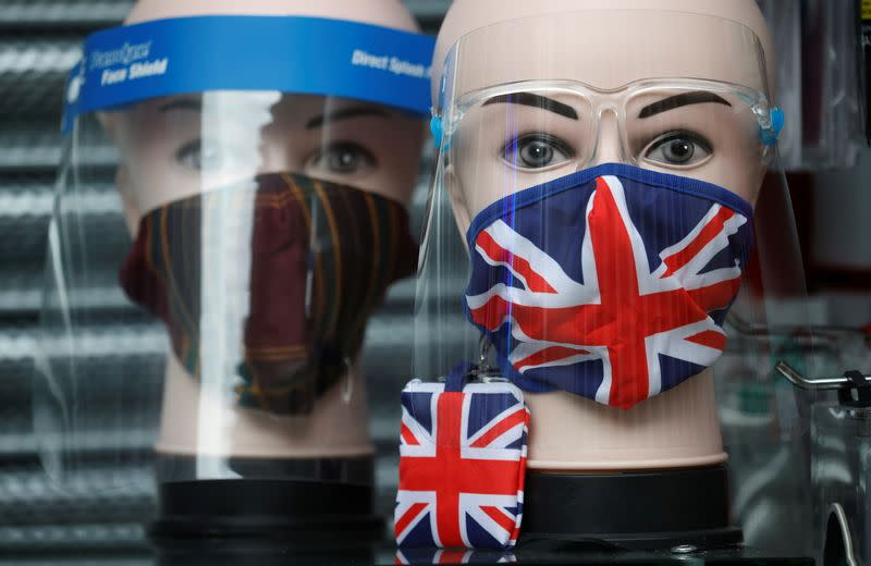 A Union Jack design face mask is seen for sale in the window of a shop amid the outbreak of the coronavirus disease (COVID-19) in Manchester