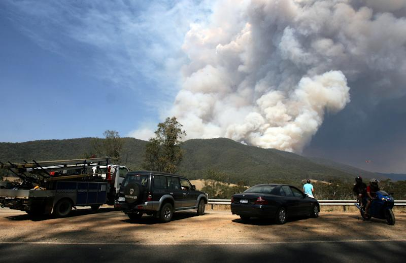 Fire burning from mountain near Bright, which turned the Victorian Alpine Region into a ghost town.