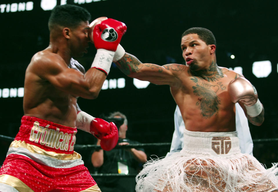CORRECTS DATE - Gervonta Davis, right, lands a punch on Yuriorkis Gamboa during round eight for the WBA lightweight boxing bout Sunday, Dec. 29, 2019, in Atlanta. Davis won the title by a 12th round TKO. (AP Photo/Tami Chappell)
