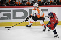 Philadelphia Flyers right wing Wade Allison (57) skates with the puck past Washington Capitals left wing Conor Sheary (73) during the first period of an NHL hockey game Saturday, May 8, 2021, in Washington. (AP Photo/Nick Wass)