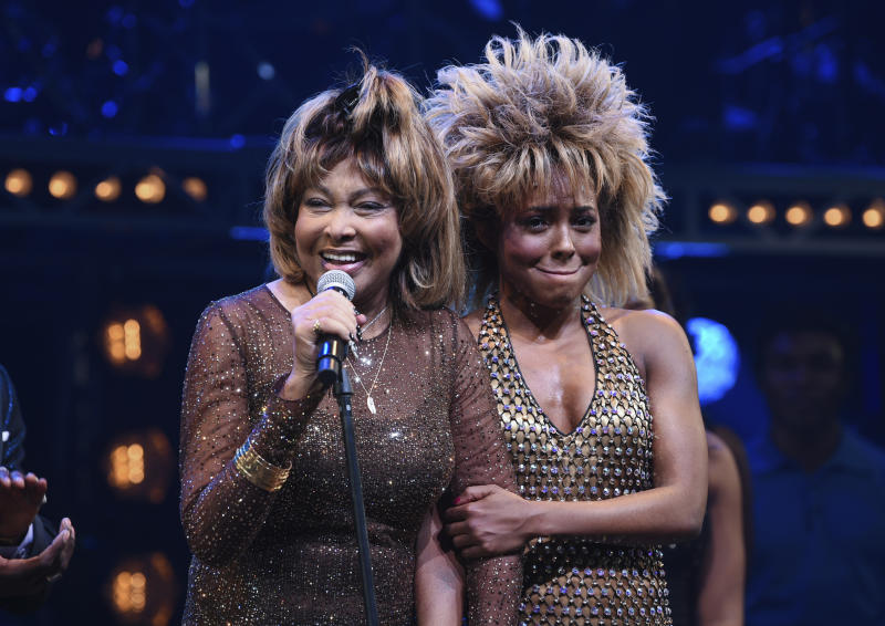 "Singer Tina Turner, left, speaks on stage with actress Adrienne Warren on the opening night of ""Tina – The Tina Turner Musical"" at the Lunt-Fontanne Theatre on Thursday, Nov. 7, 2019, in New York. (Photo by Evan Agostini/Invision/AP)"