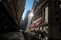 The U.S. flag is raised on the front facade of the NYSE in New York