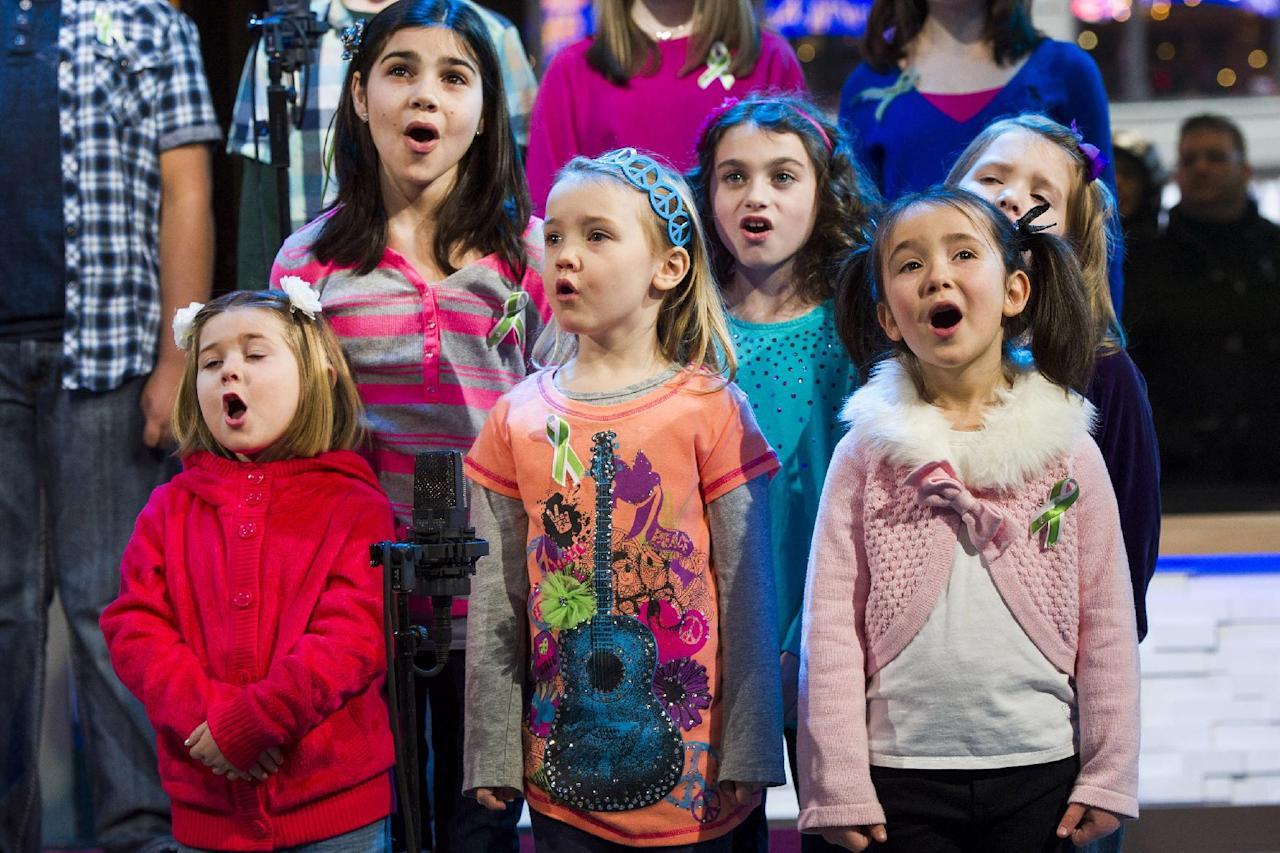 "Children from Newtown, Conn. and Sandy Hook Elementary school perform ""Somewhere Over the Rainbow"" on ABC's ""Good Morning America"" on Tuesday, Jan. 15, 2013 in New York. The Children who survived last month's shooting rampage, recorded a version of ""Over the Rainbow"" to raise money for charity. They recorded the song at the home of two former members of the Talking Heads rock band. It went on sale Tuesday on Amazon and iTunes, with proceeds benefiting a local United Way and the Newtown Youth Academy. (Photo by Charles Sykes/Invision/AP)"