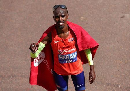 Athletics - London Marathon - London, Britain - April 22, 2018 Britain's Mo Farah reacts after finishing third in the men's elite race REUTERS/Peter Cziborra