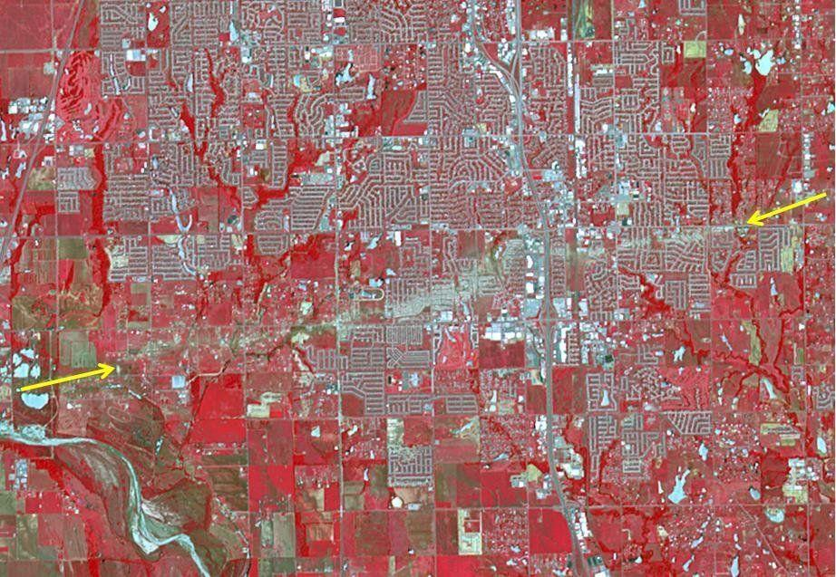 The Newcastle-Moore EF-5 tornado ripped through central Oklahoma on May 20, 2013, killing 24 people and leaving behind more than $2 billion in damage. On June 2, 2013, the Advanced Spaceborne Thermal Emission and Reflection Radiometer instrument on NASA's Terra spacecraft captured this image showing the scar left on the landscape by the tornado's deadly track. In this false-color image, vegetation is red, water is dark blue, roads and buildings are gray and white, and bare fields are tan. The tornado track crosses the image from left to right as indicated by the arrows. The image covers an area of 6 by 8.6 miles, and is located at 35.3 degrees north latitude, 97.5 degrees west longitude.