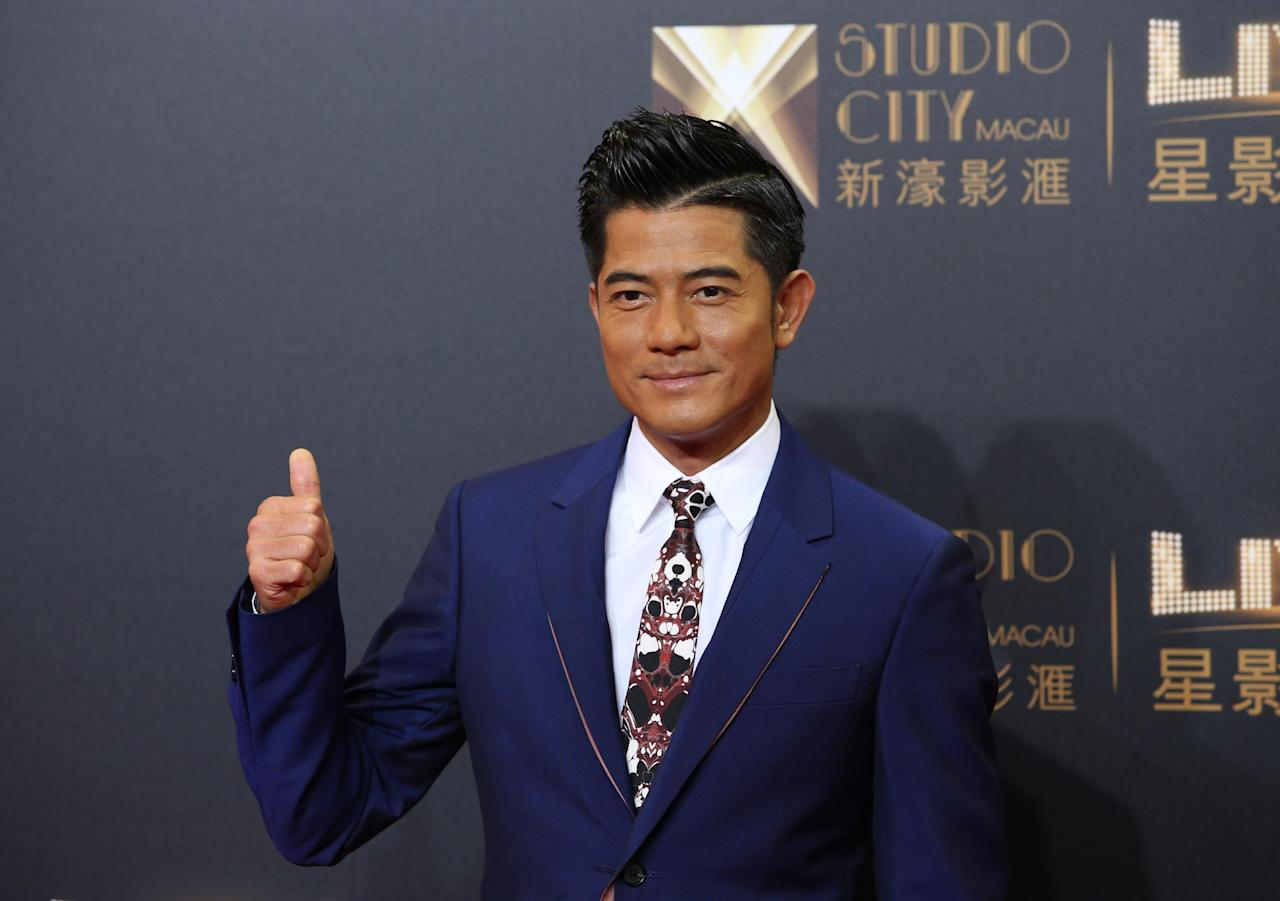 "FILE - In this Tuesday, Oct. 27, 2015, file photo, Hong Kong actor-singer Aaron Kwok poses on the red carpet of the opening ceremony for the Studio City project in Macau. A leading 13 nominations went to ""Port of Call,"" a thriller about a detective looking into a heinous crime that tore apart two families and is loosely based on a real Hong Kong crime at the Hong Kong Film Awards. It's up for best film, best actor for Hong Kong superstar Aaron Kwok and best director for Philip Yung, for whom ""Port of Call"" was his third feature.   (AP Photo/Kin Cheung)"