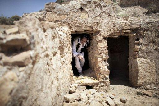 Libyan Omar Aboud, from the ancient Amazigh (Berber) tribe, leaves the entrance to the Mikveh (ritual bath) inside one of the surviving synagogues in the Berber village of Yefren in western Libya on July 13. For centuries, Jews lived among the Berbers of Yafran, observing the Sabbath at the synagogue of Ghriba, but they suddenly left 63 years ago, and their land in Libya remains untouched