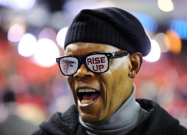Samuel L. Jackson, cheers for the Atlanta Falcons during an NFL football game against the New Orleans Saints, Thursday, Nov. 21, 2013 in Atlanta.(AP Photo/Atlanta Journal-Constitution, Curtis Compton)