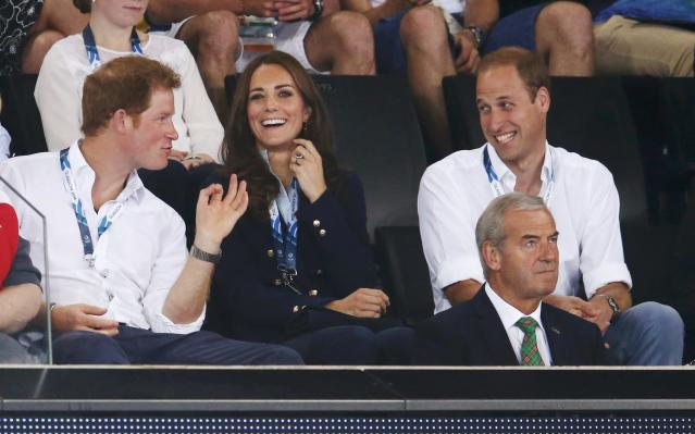 Catherine (C), Duchess of Cambridge, Prince William (R), Duke of Cambridge, and Prince Harry watch artistic gymnastics at the 2014 Commonwealth Games in Glasgow, Scotland, July 28, 2014. REUTERS/Phil Noble (BRITAIN - Tags: SPORT GYMNASTICS ROYALS)