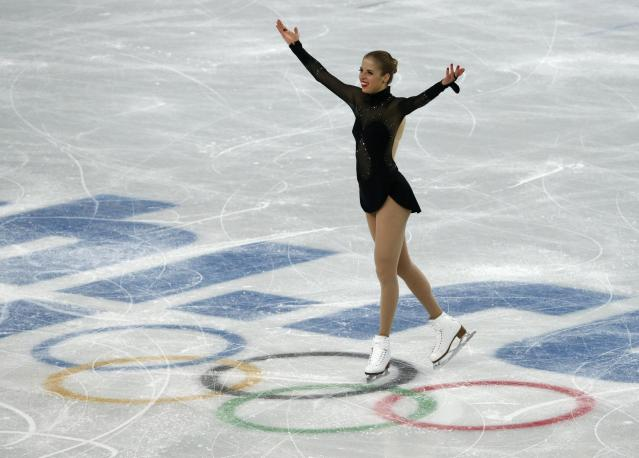 Italy's Carolina Kostner finishes her figure skating women's free skating program at the 2014 Sochi Winter Olympics, February 20, 2014. REUTERS/David Gray (RUSSIA - Tags: OLYMPICS SPORT FIGURE SKATING)