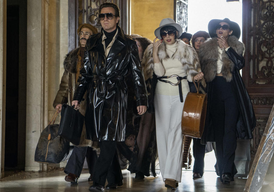 """This image released by Netflix shows David Pittu as Joe Eula, from left, Ewan McGregor as Halston, Krysta Rodriguez as Liza Minnelli and Rebecca Dayan as Elsa Peretti in a scene from """"Halston."""" A new series about the fashion designer premieres Friday on Netflix. (Atsushi Nishijima/Netflix via AP)"""