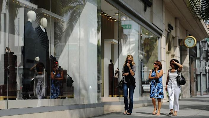 Shoppers along Beverly Hill's Rodeo Drive look into the Salvadore Ferragamo store in 2011.