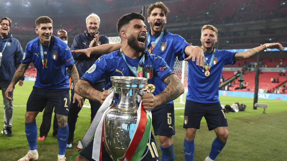Italy's Lorenzo Insigne celebrates with the trophy after the final of the Euro 2020 soccer final match between England and Italy at Wembley stadium in London, Sunday, July 11, 2021. (Andy Rain/Pool Photo via AP)