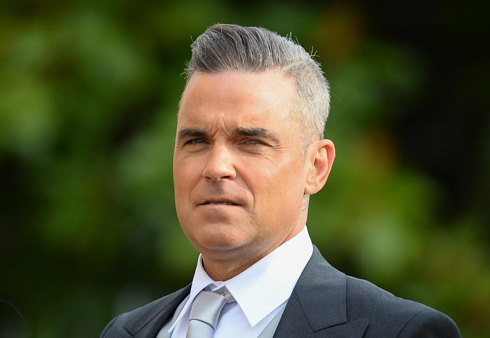 WINDSOR, ENGLAND - OCTOBER 12:  Robbie Williams attends the wedding of Princess Eugenie of York and Jack Brooksbank at St George's Chapel in Windsor Castle on October 12, 2018 in Windsor, England.  (Photo by Pool/Samir Hussein/WireImage)