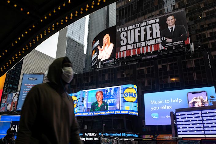 Images of Ivanka Trump and Jared Kushner are seen alongside messages about coronavirus disease (COVID-19) infections and deaths on billboards sponsored by The Lincoln Project above Times Square in New York City, U.S. October 24, 2020. Trump and Kushner's lawyer Marc Kasowitz has demanded that the billboards be removed, threatening a lawsuit.   REUTERS/Jeenah Moon