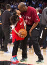 In this Feb. 14, 2016, file photo, Los Angeles Lakers Kobe Bryant (24) kisses his daughter Gianna on the court in warm-ups before first half NBA All-Star Game basketball action in Toronto. Bryant, his 13-year-old daughter, Gianna, and several others are dead after their helicopter went down in Southern California on Sunday, Jan. 26, 2020. (Mark Blinch/The Canadian Press via AP)