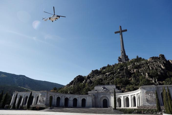 A military helicopter carrying the coffin with the remains of Spanish dictator General Francisco Franco overflies the Fallen mausoleum near El Escorial, outskirts of Madrid, Spain, Thursday, Oct. 24, 2019. Forty-four years after his demise, the remains of Spanish dictator Gen. Spain has exhumed the remains of Spanish dictator Gen. Francisco Franco from his grandiose mausoleum outside Madrid so he can be reburied in a small family crypt north of the capital. (AP Photo/Mariscal, Pool)