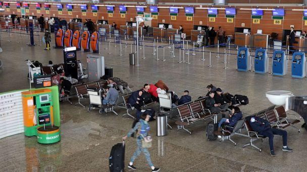PHOTO: Passengers at Sheremetyevo International Airport on the first day of an international flight ban ordered by the government amid the ongoing COVID-19 pandemic and effective since March 27. (Marina Lystseva/TASS/Newscom)
