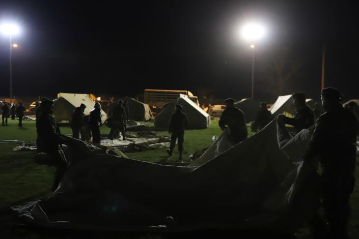 Greek Army set up a tent after an earthquake in Damasi village, central Greece, Wednesday, March 3, 2021. An earthquake with a preliminary magnitude of at least 6.0 struck central Greece Wednesday and was also felt in neighboring Albania and North Macedonia, and as far as Kosovo and Montenegro. (AP Photo/Vaggelis Kousioras)