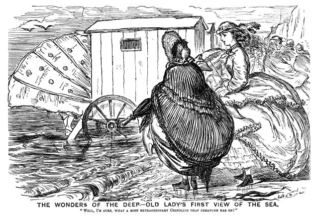 An old lady, visiting the seaside for the first time, is surprised by a bathing machine and its modesty shield. From a bound volume of copies of <em>Punch Almanack</em>for 1865-79. (Getty Images)