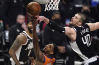 Phoenix Suns guard Cameron Payne, left, has his shot blocked by Los Angeles Clippers center Ivica Zubac during the first half in Game 3 of the NBA basketball Western Conference Finals Thursday, June 24, 2021, in Los Angeles. (AP Photo/Mark J. Terrill)