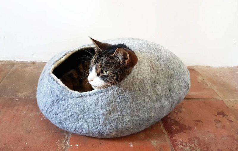 "<a href=""https://fave.co/2sklkYS"" target=""_blank"" rel=""noopener noreferrer"">Natural Felt Cat Bed, Love Cat Caves, via Not On the High Street</a>, &pound;49.50 (Photo: HuffPost UK)"