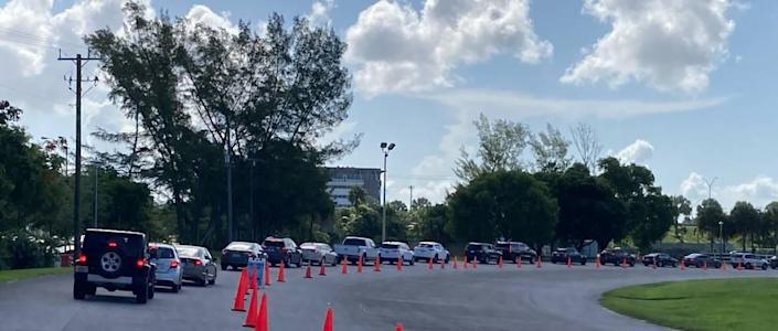 At Tropical Park, which serves as a drive-thru COVID testing and vaccine site, the line of cars went up to the park's entrance at Southwest 79 Avenue and Bird Road Thursday morning, July 22, 2021.