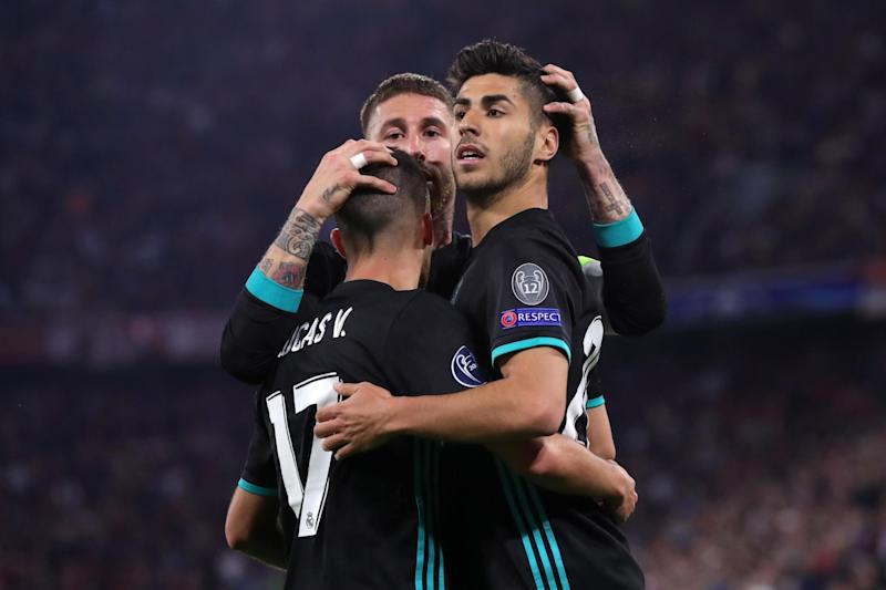 Crime fighting? | Real Madrid's starring duo, Vazquez (left) Asensio (right) celebrate with Sergio Ramos: Bongarts/Getty Images