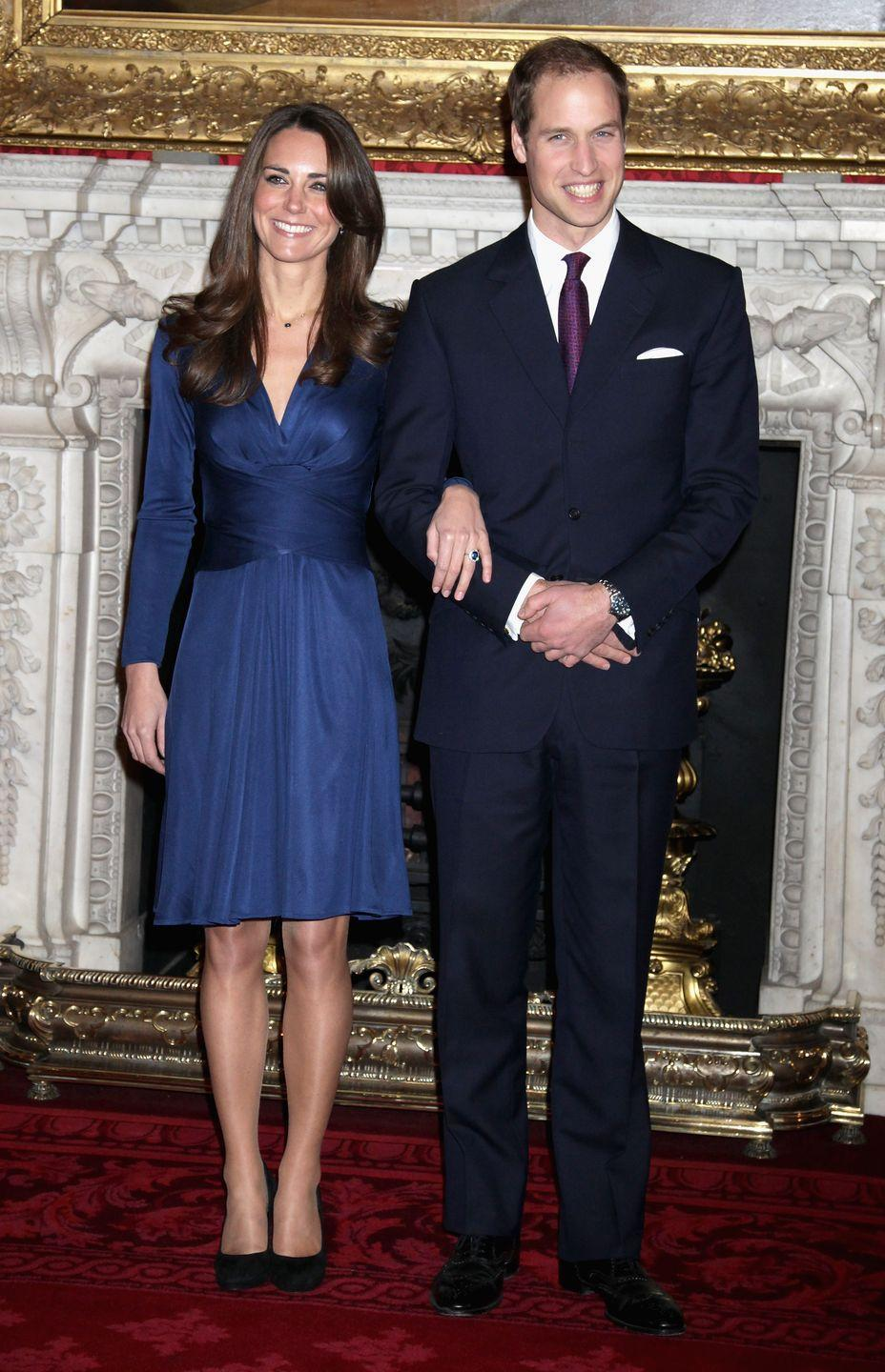 <p>The couple poses for photographs after their engagement is announced.<br></p>