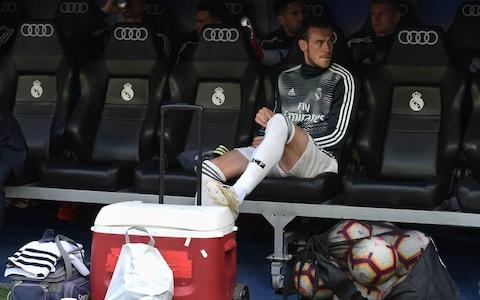 Gareth Bale of Real Madrid looks on from the substitute bench before the La Liga match between Real Madrid CF and Real Betis Balompie at Estadio Santiago Bernabeu - Credit: Getty images