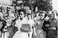 <p>Elizabeth Eckford ignores the hostile screams and stares of fellow students on her first day of school. She was one of the nine Black students whose integration into Little Rock's Central High School was ordered by a Federal Court following legal action by the NAACP.</p>