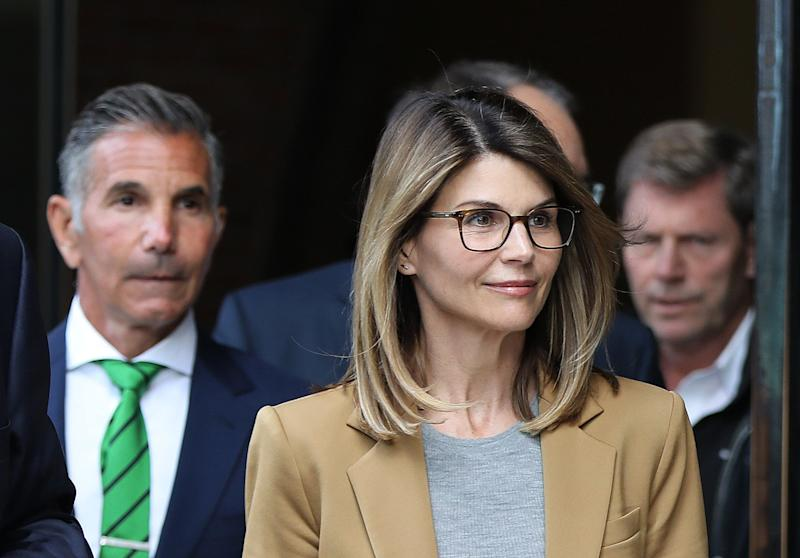 Lori Laughlin and Mossimo Giannulli leaving court in Boston in April. (Photo: Getty Images)