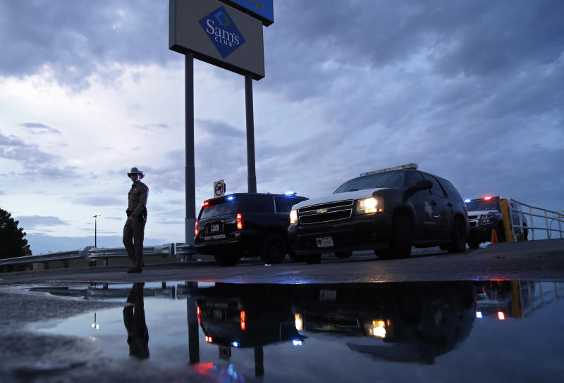 Law enforcement officials block a road at the scene of a mass shooting at a shopping complex Sunday, Aug. 4, 2019, in El Paso, Texas. (Photo: John Locher/AP)