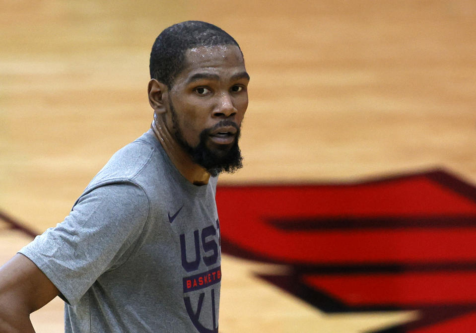 Kevin Durant looks toward the camera while taking a break at Team USA camp.