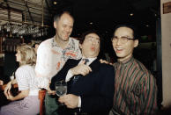 """FILE - In this July 21, 1988, file photo, comedian Jackie Mason, holding a glass, enjoys a joke with John Lithgow, left, and B.D. Wong, stars of the Tony award-winning Broadway show """"M. Butterfly,"""" at the Stage Deli in New York. Mason hosted a late-night supper party in honor of the 1988 Tony winners and Broadway's summer season. Mason, a rabbi-turned-jokester whose feisty brand of standup comedy got laughs from nightclubs in the Catskills to West Coast talk shows and Broadway stages, has died. He was 93. Mason died Saturday, July 24, 2021, in Manhattan, the celebrity lawyer Raoul Felder told The Associated Press. (AP Photo/Adam Stoltman, File)"""