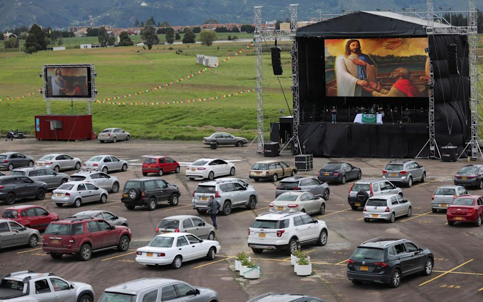 Cars parked with social distance are seen during a drive-in mass celebrated in a parking lot in Chia, Colombia - Reuters